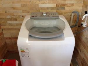 Máquina de lavar roupas para os hóspedes
